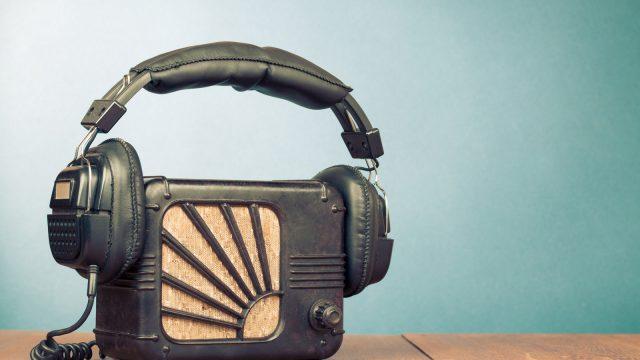 Retro radio and headphones on table